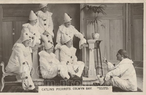 Catlin's Pierrots Colwyn Bay, seated, listening to Will Catlin