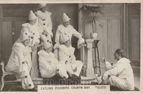 Catlin's Pierrots Colwyn Bay, seated, listening to Will Catlin