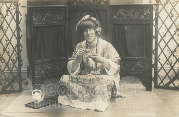 Will Catlin in drag Japenese woman with tea
