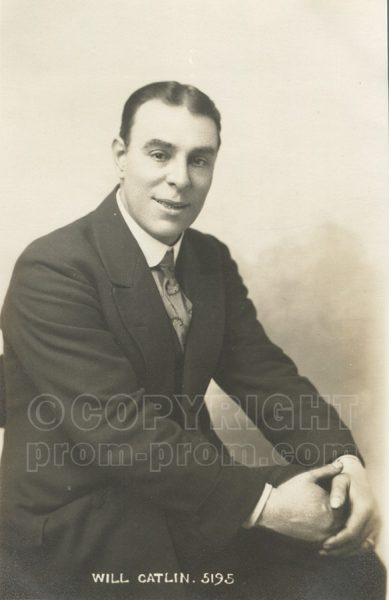 Will Catlin studio photo seated hands on knees