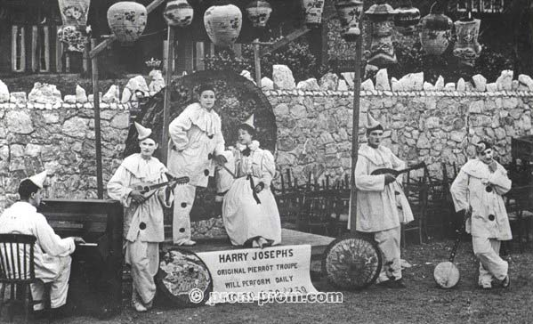 Harry Joseph's Original Pierrot Troupe against beach hotel wall Littlehampton c1900