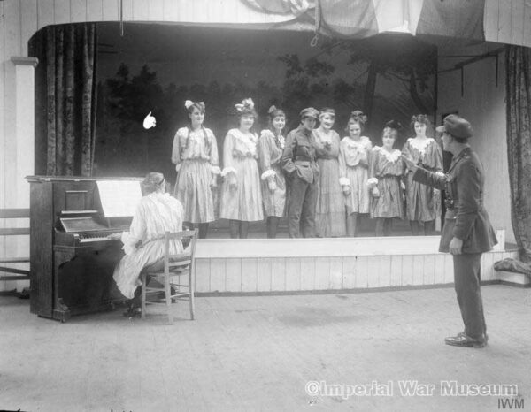 Concert party organised by women carpenters at the Tarrant Hut Works near Calais, 3 December 1918, to give performances to wounded soldiers. - IWM archives