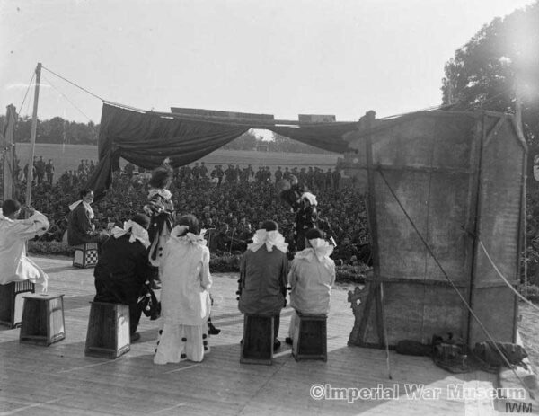 Soldiers watching a concert party at No. 14 Convalescent Depot at Trouville, 16 August 1918. - IWM archives