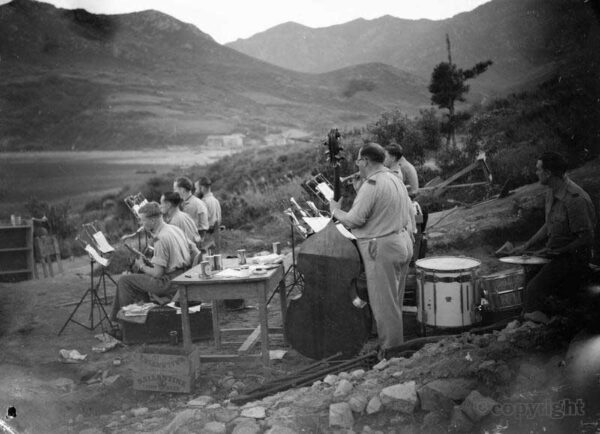 The Royal Marine Band from HMS BELFAST entertains troops ashore in Korea, September 1952