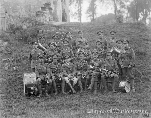 The regimental band of the 39th Battalion, Machine Gun Corps at Rombly, 20 July 1918. - IWM archives