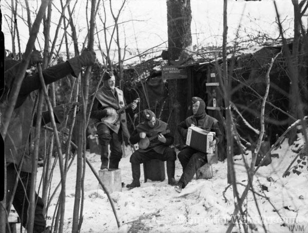 Three airmen The Grosvenor House Orchestra, snow-covered airfield in France
