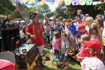 Uncle-Tacko-Flea-Circus-outdoors-with-crowd-and-bunting